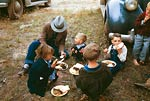 Children eating barbeque, Pie Town 1940