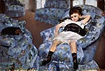small girl in the blue armchair Mary Cassatt