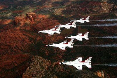 Thunderbirds flying in a six-ship delta formation