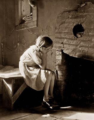 1930's America, resettled farm child girl staring into fireplace