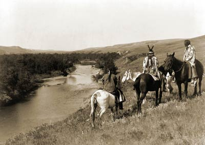 3 Piegan Indians, four horses 1910