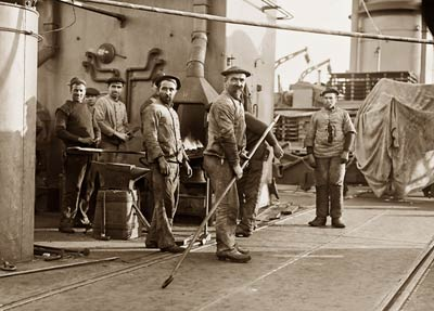 Deck hands on the French navy cruiser Amiral Aube