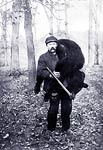Hunter Carrying a Large Bear.