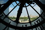 View through Orsay clock, across city of Paris