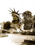 Head of Statue of Liberty on display in park in Paris
