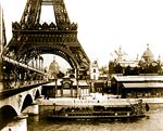 Eiffel Tower as seen from the River Seine, with bateau mouche Pa